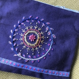 Pouch on line embroidered